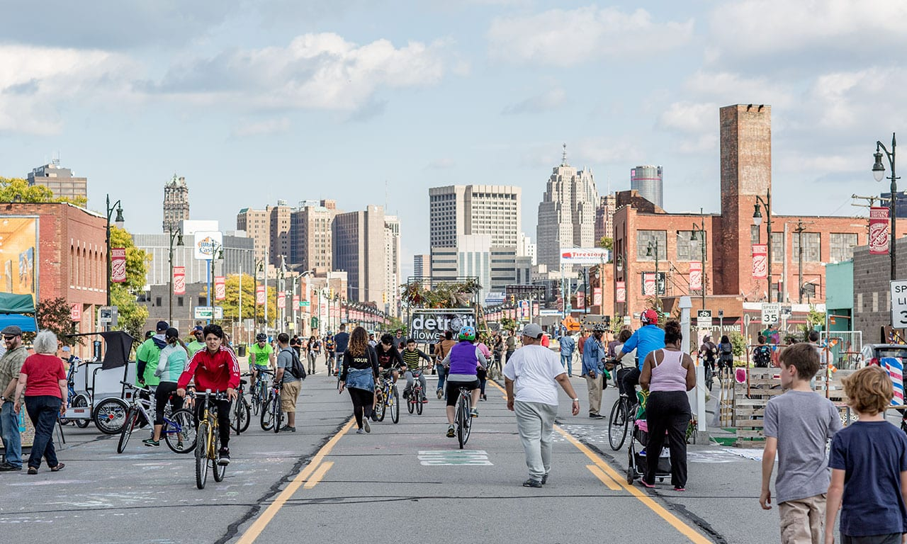 Image of people walking in the streets of Detroit.